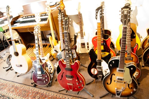 Peter's arsenal of guitar and basses. Photo by Colin Kerrigan